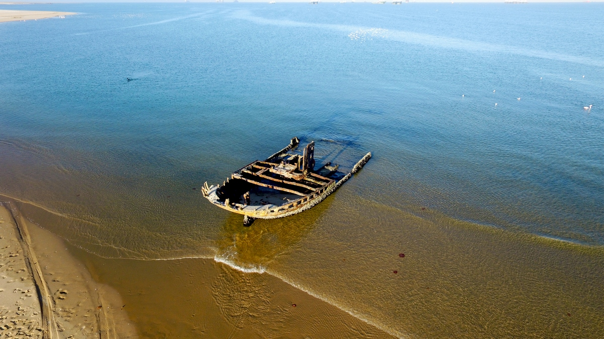 Unknown shipwreck - aerial drone photo, near Pelican Point Lodge, Walvis Bay, Namibia